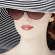 Fashion women in wide hat — Stock Photo #22013907