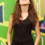 Style teen girl in sunglasses near graffiti background. — Stock Photo #22014001