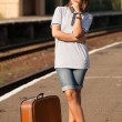 Stock Photo: Hipster girl at railways platform.