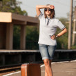Hipster girl at railways platform. — Stock Photo #22349191