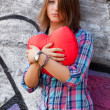 Teen girl with heart at outdoor. — Stock Photo #22349209