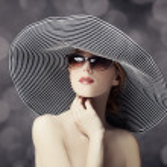 Fashion women in wide hat — Stock Photo #22349401