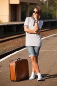 Hipster girl at railways platform. — Stock Photo