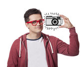A young man show abstract hipster's camera — Stock Photo