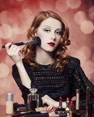 Woman applying cosmetics — Stock Photo