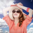 Beautiful red-haired girl in hat at white background — Stock Photo