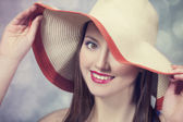 Beautiful girl in hat at bokeh background — Stock Photo