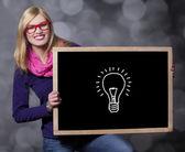 Smiling teen girl with blackboard. — Stock Photo
