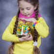 Stock Photo: Little girl with jelly bean.