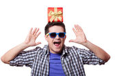A man with present box on the head, white background. — Stock Photo