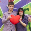 Teens with heart near graffiti wall. — Foto de Stock
