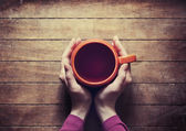 Woman holding hot cup of tea — Stock Photo