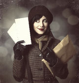 Young postman girl with mail. Photo in old color style with boke — Стоковое фото