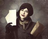 Young postman girl with mail. Photo in old color style with boke — Stok fotoğraf