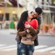 Young couple kissing on the street — Stock Photo #24549611