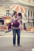 Couple kissing at alley in city. — Stock Photo