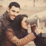 Couple viewing in binocular. — Stock Photo #24559901
