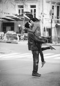 Young couple kissing on the street — Stok fotoğraf