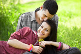 Couple Relaxing on Green grass — Stock Photo