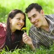 Couple Relaxing on Green Grass.Park. — Stock Photo