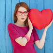 Style girl with toy heart — Stok fotoğraf