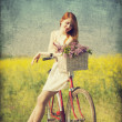 Girl on a bike in the countryside. — 图库照片