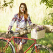 Girl on a bike in the countryside — 图库照片