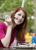 Style redhead girl with cake and cup — Stock Photo