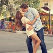 Young couple kissing on the street — Stockfoto