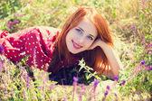 Redhead girl at green grass at village outdoor — Stock Photo