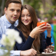 Young couple in the cafe — Stock Photo