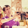 couple drinking wine in the cafe — Stock Photo