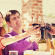 Couple drinking wine in the cafe — Stock Photo #26311245
