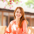 Style redhead girl sitting in the cafe - Stock Photo
