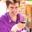 Man with wine in the cafe — Stock Photo