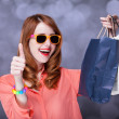 Redhead women with sopping bags. — Stock Photo