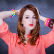 Beautiful red-haired girl at bokeh background — Stock Photo