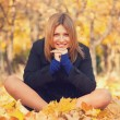 Stock Photo: Smiling happy girl in autumn park.