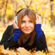 Portrait of a woman at outdoor with headphones. — Stock Photo