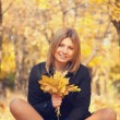 Smiling happy girl in autumn park. — Stock Photo #27349797