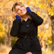Portrait of a woman at outdoor with headphones. — Stock Photo #27349811
