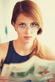Redhead women reading newspaper. — Stock Photo