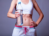 Sport woman with bottle. — Stock Photo