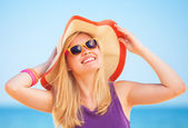 Blonde girl on the beach in spring time. — Stock Photo