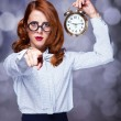 Redhead women with clock. — Stock Photo