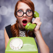 Redhead women with green telephone.  — Stock Photo