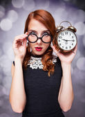 Surprised redhead girl with clock. — Stock Photo