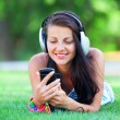 Brunette girl with headphones at outdoor — Stock Photo #28005027