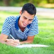 Young student with note at outdoor — Stock Photo