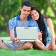 Students with laptop at outdoor — Stock Photo